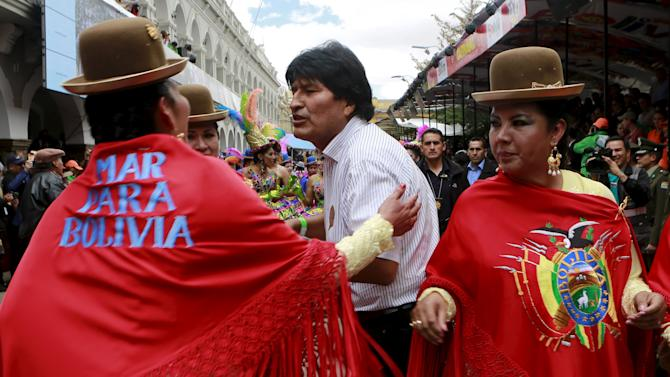 Bolivia's President Evo Morales (C) talks with members  of Morenada Central Norte  during the carnival parade in  Oruro
