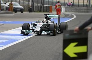 Mercedes Formula One driver Lewis Hamilton of Britain drives to a pit stop during the Chinese F1 Grand Prix at the Shanghai International Circuit