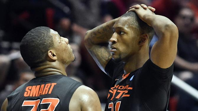 Oklahoma State's Marcus Smart, left, looks to the scoreboard as teammate Kamari Murphy shows his frustration during the second half of their 85-77 loss to Gonzaga in a second-round game in the NCAA college basketball tournament Friday, March 21, 2014, in San Diego