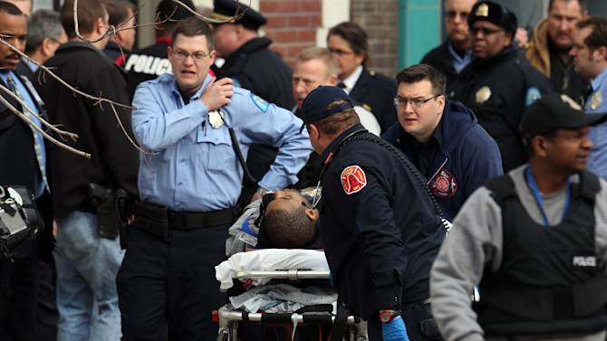 Police and emergency personal respond to a shooting victim at Stevens Institute of Business and Arts in St. Louis on Tuesday, Jan. 15, 2013.  Police say a gunman entered the school and shot a person in the chest, then shot himself.  Everyone inside the building was evacuated, though police were checking the school to make sure the building was empty.  The conditions of the shooting victims were not immediately known.  (AP Photo/St. Louis Post-Dispatch, David Carson)