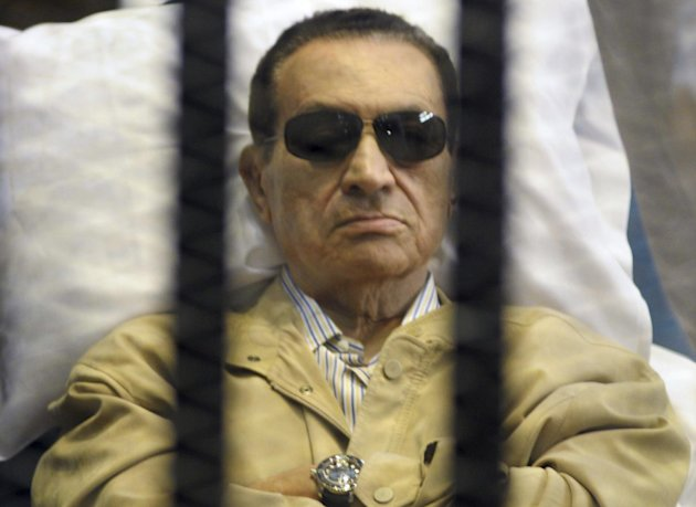 FILE - In this Saturday, June 2, 2012 file photo, Egypt&#39;s ex-President Hosni Mubarak lays on a gurney inside a barred cage in the police academy courthouse in Cairo, Egypt. Doctors used a defibrillator twice on Hosni Mubarak when they could not find a pulse Monday, the latest health crisis for the ousted Egyptian president since he was sentenced to life and moved to a prison hospital nine days ago, security officials said. In his last public appearance at his June 2 sentencing, the bedridden Mubarak sat stone-faced in the defendants&#39; cage in the courtroom, his eyes hidden behind dark glasses. Officials said he broke into tears when he learned he was being transferred to a prison. (AP Photo, File)