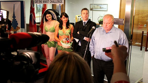 Toronto Mayor Rob Ford, shown beside vegan demonstrators on April 16, has lost a further two pounds.