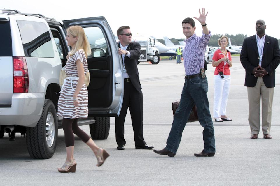 Republican vice presidential candidate, Rep. Paul Ryan, R-Wis.,  and his wife Janna, arrive at Tampa International Airport, in Tampa, Fla., Tuesday, Aug. 28, 2012.  (AP Photo/Mary Altaffer)