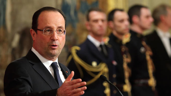 French President Francois Hollande, gestures as he speaks during as he awards French sociologist Alfred Grosser, unseen, with the Grand Officier of the Legion d'Honneur during a ceremony at the Elysee Palace in Paris, Tuesday, April 2, 2013. (AP Photo/Philippe Wojazer, Pool)