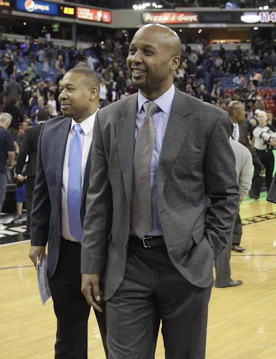 Denver Nuggets head coach Brian Shaw smiles as he walks off the court after defeating the Sacramento Kings 125-117 in an NBA basketball game in Sacramento, Calif., Sunday, Jan. 26, 2014
