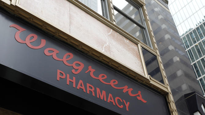FILE - In this June 20, 2011 file photo, a Walgreens pharmacy sign is displayed in Philadelphia. The nation's largest drugstore chain says it earned $353 million, or 39 per share, in its 2012 fiscal fourth quarter. (AP Photo/Matt Rourke, File)