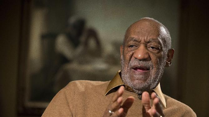 "FILE - In this Nov. 6, 2014 file photo, Entertainer Bill Cosby gestures during an interview about the upcoming exhibit, Conversations: African and African-American Artworks in Dialogue, at the Smithsonian's National Museum of African Art, in Washington.  Cosby's appearance at Tuscon's Desert Diamond Casino has been canceled. No reason was given by the casino for the canceled date, which had been scheduled for Feb. 15. In the past week, numerous allegations of sexual abuse by Cosby from a number of women have led to canceled interviews and NBC and Netflix projects. ""The Cosby Show"" also was pulled off the air on TV Land. Cosby issued a statement Sunday discrediting decades-old accusations and his attorney has denied four of the allegations. (AP Photo/Evan Vucci)"