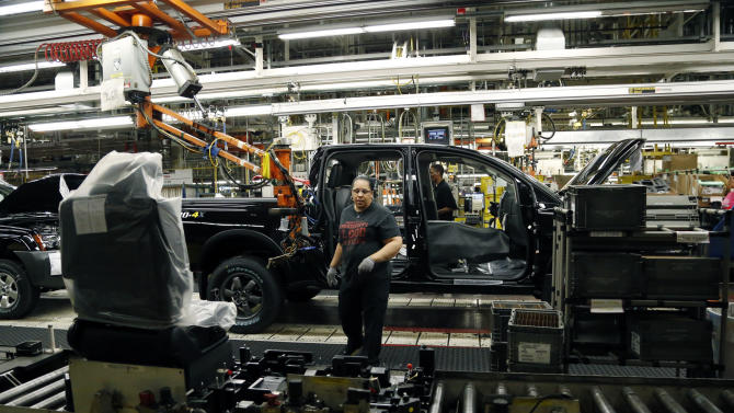 FILE - In this Thursday, Jan. 10, 2013 file photo, a Nissan employee reaches for a seat module to insert into a Titan truck at its Canton, Miss., manufacturing plant. The Federal Reserve reports on production from factories, mines and utilities in January on Friday, Feb. 15, 2013. (AP Photo/Rogelio V. Solis, File)