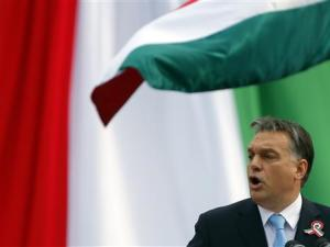 Hungarian Prime Minister Orban delivers a speech during the 166th anniversary of the anti-Habsburg revolution in Budapest