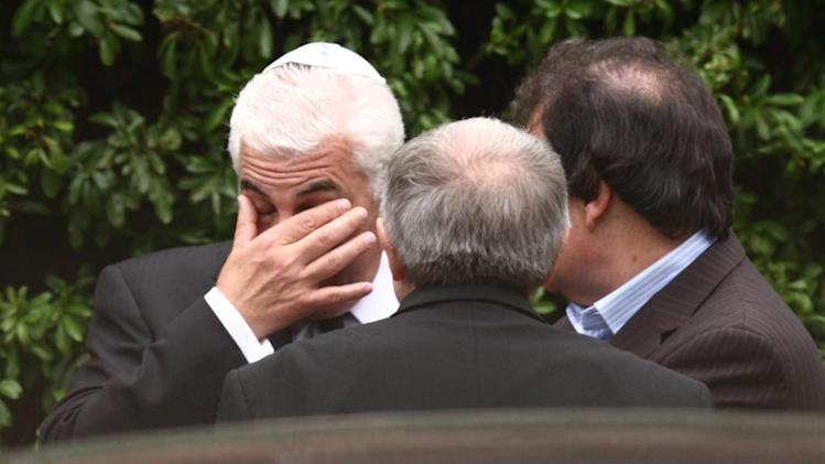 Mitch Winehouse wipes his eyes outside Golders Green Crematorium in London, Tuesday July 26, 2011, following the funeral of his daughter, singer Amy Winehouse.  The soul diva, who had battled alcohol and drug addiction, was found dead Saturday at her London home. She was 27.(AP Photo/Steve Parsons-pa)  UNITED KINGDOM OUT: NO SALES: NO ARCHIVE: