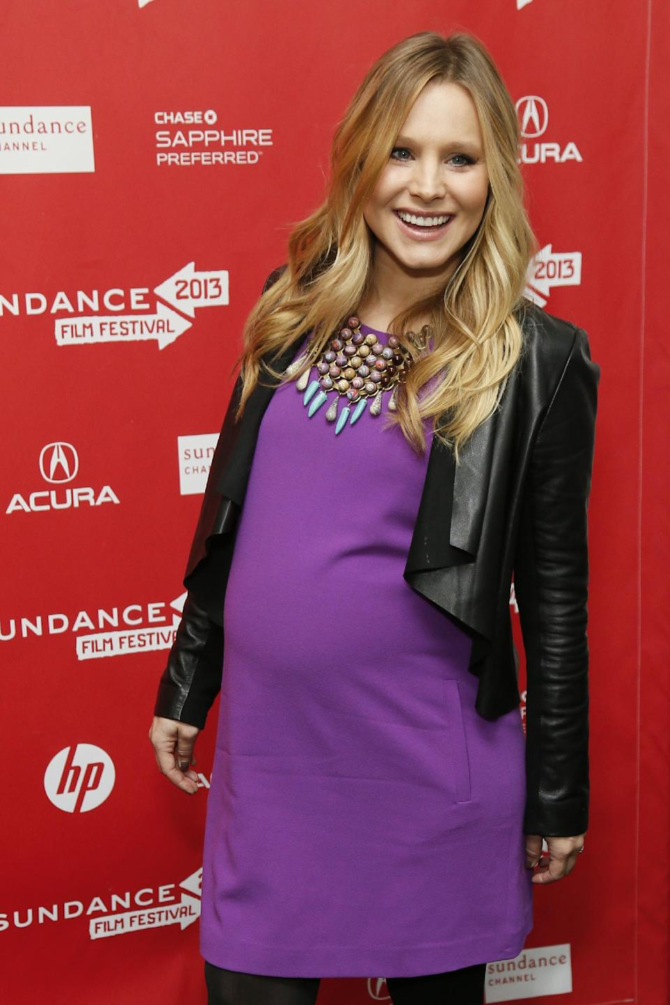"FILE - This Jan. 19, 2013 file photo shows  pregnant actress Kristen Bell at the premiere of ""The Lifeguard"" during the 2013 Sundance Film Festival in Park City, Utah.  Fashion experts say a streamlined style best suits a baby bump. (Photo by Danny Moloshok/Invision/AP, file)"