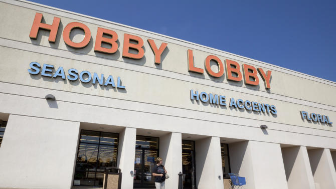 FILE - In this Sept. 12, 2012 file photo, a woman walks from a Hobby Lobby Inc., store in Little Rock, Ark. Christian pastors plan to deliver petitions to Hobby Lobby officials in protest of the Oklahoma-based company's lawsuit challenging health care guidelines that require the coverage of the morning-after pill. (AP Photo/Danny Johnston, File)