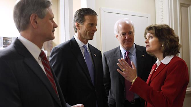 FILE - In this Feb. 29, 2012, file photo Republican Sen. Lisa Murkowski, R-Alaska, talks Republican Senators, from left, John Hoeven, R-N.D., John Thune, R-S.D., and Sen. John Cornyn, R-Texas, prior to a news conference on gas prices on Capitol Hill in Washington. Murkowski, 54, a moderate in an era of paralyzing partisanship, may be a natural heir to the centrist role played by retiring Maine Sen. Olympia Snowe at a time when their party is hurting for female leaders. (AP Photo/Jacquelyn Martin, File)