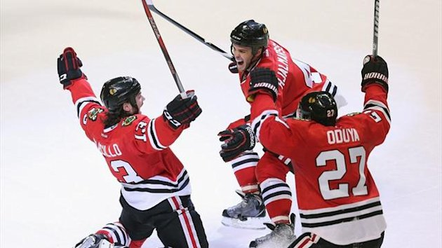 Daniel Carcillo #13 of the Chicago Blackhawks celebrates his game-winning goal against the Colorado Avalanche at the United Center (AFP)
