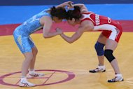 Canada's Tonya Lynn Verbeek (right) wrestles Japan's Saori Yoshida in their women's 55kg freestyle Olympic gold medal match on August 9, 2012 in London. Wrestlers around the world on Wednesday vowed to fight to save the ancient sport's Olympic status, after the International Olympic Committee voted to drop it for the 2020 Games