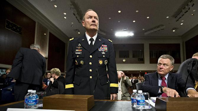 Gen. Keith B. Alexander, director of the National Security Agency and head of the U.S. Cyber Command, prepares to answer questions from lawmakers on Capitol Hill in Washington, Wednesday, June 12, 2013, before the Senate Appropriations Committee. It is his first public appearance before Congress since revelations that the electronic surveillance agency is sweeping up Americans' phone and Internet records in its quest to investigate terrorist threats. At right is Rand Beers, under secretary for the Department of Homeland Security.  (AP Photo/J. Scott Applewhite)