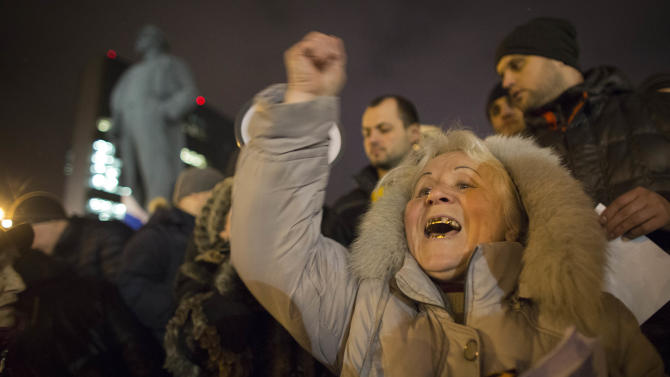 Pro-Russia protesters shout slogans during a small demonstration in Donetsk, eastern Ukraine, Wednesday, Feb. 26, 2014. President Vladimir Putin on Wednesday ordered massive exercises involving most military units in western Russia amid tensions in Ukraine. (AP Photo/Darko Bandic)