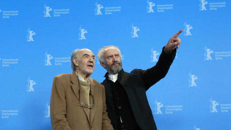 Director and producer George Sluizer and actor Jonathan Pryce pose at the photo call for the film Dark Blood at the 63rd edition of the Berlinale, International Film Festival in Berlin, Thursday, Feb. 14, 2013. (AP Photo/Gero Breloer)