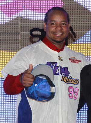 FILE - In this March 12, 2013 file photo, former Major League Baseball star Manny Ramirez poses for media wearing his new jersey after signing a short-term contract to play on the EDA Rhinos in Taiwan's professional baseball league, in Kaohsiung, Taiwan. The Texas Rangers have signed Ramirez to minor league contract. Ramirez spent three months playing in Taiwan before leaving the team on June 20. The Rangers made the announcement Wednesday, July 3, 2013. (AP Photo/Wally Santana, File)