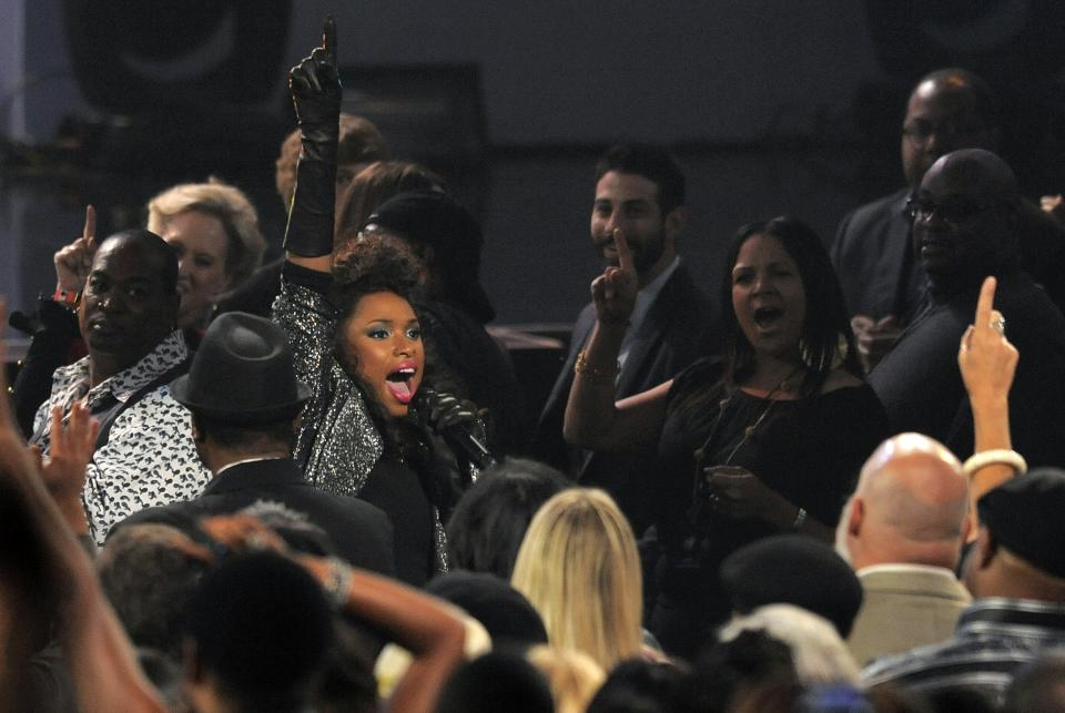 "Singer Jennifer Hudson wades into the audience at ""We Will Always Love You: A Grammy Salute to Whitney Houston,"" at Nokia Theatre on Thursday, Oct. 11, 2012, in Los Angeles. The one-hour concert tribute will air on CBS on Nov. 16. (Photo by Chris Pizzello/Invision/AP)"
