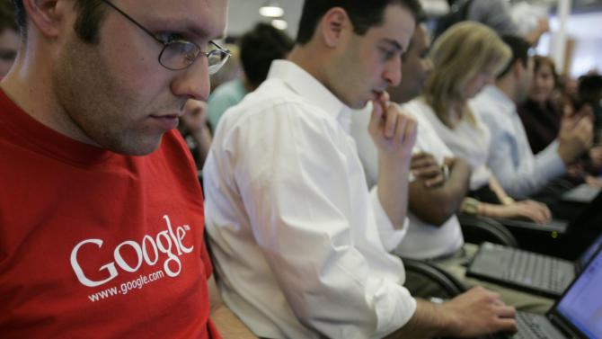 FILE - In this May 30, 2007 file photo, Google employees work on their laptops at Google headquarters in Mountain View, Calif. In a groundbreaking disclosure, Google on Wednesday, May 28, 2014 revealed how very white and male its workforce is — just 2 percent of its Googlers are black, 3 percent are Hispanic, and 30 percent are women. (AP Photo/Paul Sakuma, File)