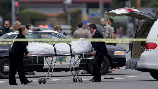 The Orange County coroner's office wheels a body to a waiting van in Orange, Calif., Tuesday, Feb. 19, 2013. Police say a chaotic 25-minute shooting spree through Orange County left a trail of dead and injured victims before the shooter killed himself. Orange County sheriff's spokesman Jim Amormino say there are at least six crime scenes with three people, including the suspected gunman, dead and several others wounded. Tustin police Supervisor Dave Kanoti said the shootings started with an apparent carjacking just after 5 a.m. Tuesday in an unincorporated Ladera Ranch area of Orange County.  (AP Photo/The Orange County Register, Mark Rightmire)   MAGS OUT; LOS ANGELES TIMES OUT