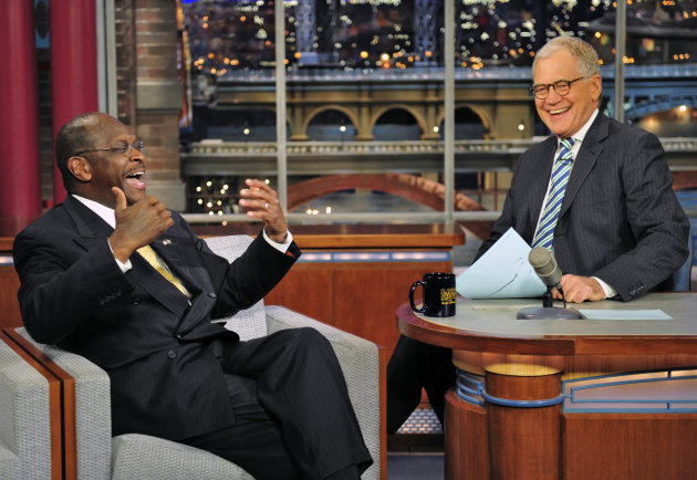 In this photo provided by CBS, Republican presidential candidate Herman Cain joins host David Letterman on the set of the ?Late Show with David Letterman,? Thursday, Nov. 17, 2011 in New York. The show airs Friday, Nov. 18. (AP Photo/CBS, John Paul Filo)