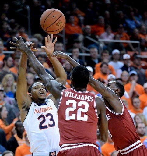 Arkansas beats Auburn 83-75 for first road win