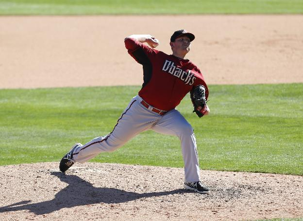 Arizona Diamondbacks relief pitcher Will Harris throws against the Chicago White Sox in the eighth inning during an exhibition baseball game in Glendale, Ariz., Saturday, March 8, 2014. (AP Photo/Paul Sancya)