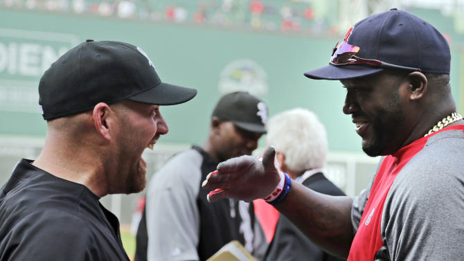 Chicago White Sox third baseman Kevin Youkilis, left, laughs with his former teammate, Boston Red Sox designated hitter David Ortiz, during batting practice before a baseball game at Fenway Park in Boston, Monday, July 16, 2012. Youkilis returned to Fenway, where he was a member of the 2004 and 2007 World Series Champion teams, for the first time since being traded. (AP Photo/Charles Krupa)