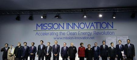 World leaders and Microsoft co-founder Bill Gates attend a meeting to launch the 'Mission Innovation: Accelerating the Clean Energy Revolution' at the World Climate Change Conference 2015 (COP21) near Paris