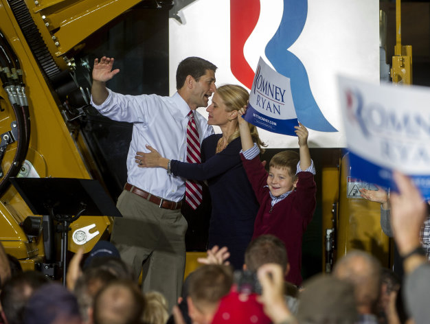 Republican vice presidential candidate Paul Ryan, R-Wis., is greeted by his wife Janna and his son Charlie, holding a sign, after his campaign speech at the Gradall Industries plant in New Philadelphia, Ohio, Saturday, Oct. 27, 2012. (AP Photo/Phil Long)