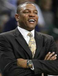 Boston Celtics coach Doc Rivers laughs during a break in play in the third quarter of Game 4 of an NBA basketball first-round playoff series against the Atlanta Hawks, in Boston on Sunday, May 6, 2012. The Celtics won 101-79. (AP Photo/Michael Dwyer)