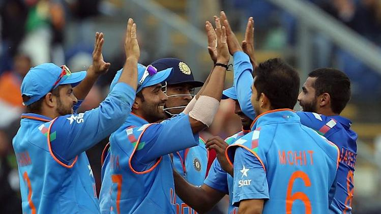 Indian players celebrate during their victory over England in the second one-day international cricket match between England and India in Cardiff, Wales on August 27, 2014