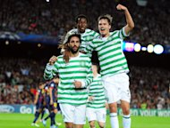 Efe Ambrose, centre, celebrates with Georgios Samaras, left, and Mikael Lustig after Celtic's goal at the Nou Camp last month
