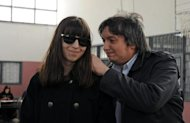 The daughter and son of Argentine President Cristina Kirchner, Florencia and Maximo, wait to cast their votes in the province of Santa Cruz, on October 27, 2013