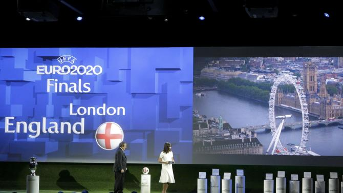UEFA President Platini announces the name of London, one of the 13 cities which will host matches at the Euro 2020 tournament to be played across the continent, next to former Miss Switzerland Winiger during a ceremony in Geneva