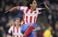 Atletico Madrid's Colombian forward Radamel Falcao celebrates after scoring during the Spanish league football match Club Atletico de Madrid vs Deportivo de la Coruna at the Vicente Calderon stadium in Madrid. Falcao became the first La Liga player in a decade to score five goals in a match as Atletico Madrid thrashed Deportivo La Coruna 6-0