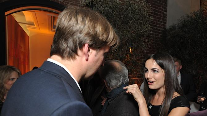 Tom Hooper, left, and Camilla Belle attend The Hollywood Reporter Nominees' Night at Spago on Monday, Feb. 4, 2013, in Beverly Hills, Calif. (Photo by John Shearer/Invision for The Hollywood Reporter/AP Images)