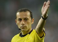 Turkey's Cuneyt Cakir, seen here on June 18, will referee the Euro 2012 semi-final between holders Spain and Portugal in Donetsk, Ukraine