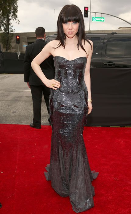 She's all grown up! Carly Rae Jepsen ditches her bubble-gum pop persona with a more mature look in a sequined silver gown with a sexy strapless corset. But maybe it's time she get a new hair cut?  (Ph