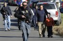 FILE - In this Friday, Dec. 14, 2012 file photo, parents leave a staging area after being reunited with their children following a shooting at the Sandy Hook Elementary School in Newtown, Conn., where Adam Lanza opened fatally shot 27 people, including 20 children. People figure there surely were signs of impending violence. But experts say predicting who will be the next mass shooter is virtually impossible _ partly because as commonplace as these calamities seem, they are relatively rare crimes. Still, a combination of risk factors in troubled kids or adults including drug use and easy access to guns can increase the likelihood of violence, experts say. (AP Photo/Jessica Hill, File)