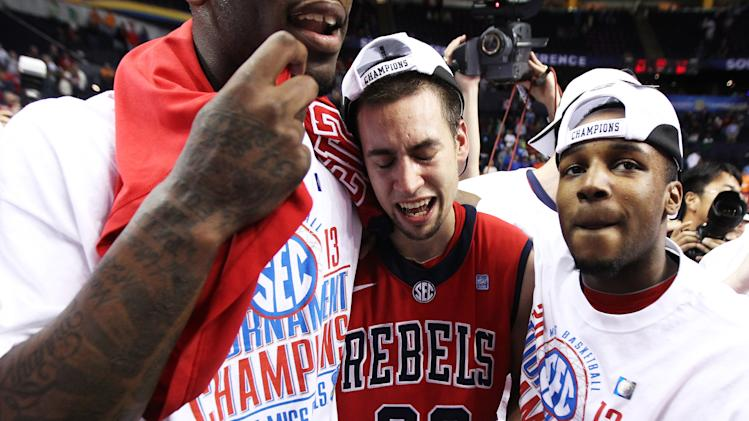 Henderson cries in the arms of his teammates after Mississippi's SEC tournament title win over Florida. (AP)