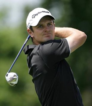 Justin Rose of England watches his tee shot on the first hole during the final round of the Memorial Tournament in Dublin