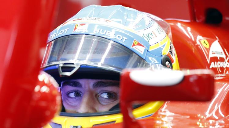 Ferrari Formula One driver Fernando Alonso of Spain sits in his car during the first practice session of the Chinese F1 Grand Prix at the Shanghai International circuit