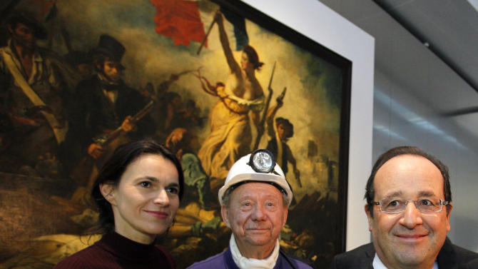 "France's President Francois Hollande, right, is seen with  Culture minister Aurelie Filippetti, left, and with a former miner, Lucien Laurent, centre, in front of "" La Liberte Guidant le Peuple"", a painting by Eugene Delacroix during the inauguration of the Louvre Museum in Lens, northern France, Tuesday, Dec. 4, 2012. The museum in Lens is to open on Dec. 12, as part of a strategy to spread art beyond the traditional bastions of culture in Paris to new audiences in the provinces. (AP Photo/Michel Spingler, Pool)"