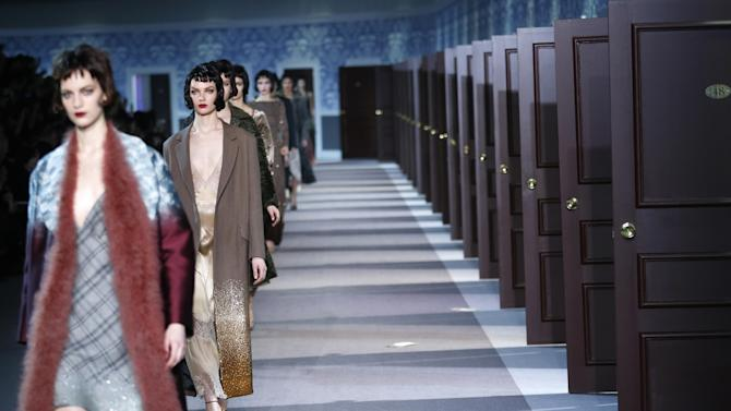 Models present creations by U.S fashion designer Marc Jacobs for Louis Vuitton's Ready to Wear's Fall-Winter 2013-2014 fashion collection, presented, Wednesday, March 6, 2013 in Paris. (AP Photo/Jacques Brinon)