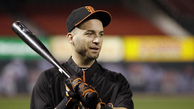 San Francisco Giants second baseman Marco Scutaro holds a bat during baseball practice, Tuesday, Oct. 16, 2012, in St. Louis. The Giants are scheduled to play the St. Louis Cardinals in Game 3 of baseball's National League championship series Wednesday in St. Louis. (AP Photo/Jeff Roberson)