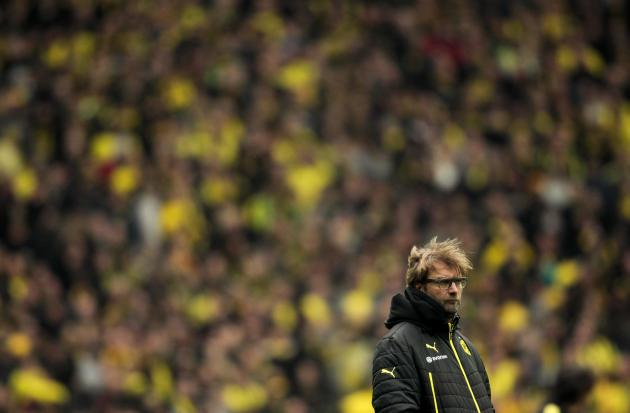 Borussia Dortmund's coach Klopp watches his team before the German first division Bundesliga soccer match against Borussia Moenchengladbach in Dortmund