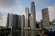 A picture shows the skyline of Singapore&#39;s financial district across the Singapore River in 2011. Singapore sovereign wealth fund GIC on Tuesday said its long-term returns held steady in the year to March but it had changed its investment mix amid fears of greater volatility ahead